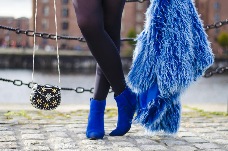 penny lark handbag via asos and best dressed secret fur long hair blue jacket